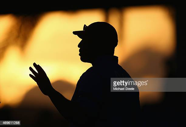 Phil Simmons the Head Coach of West Indies silhouetted aginst the setting sun as he talks to media after play on day one of the 1st Test match...