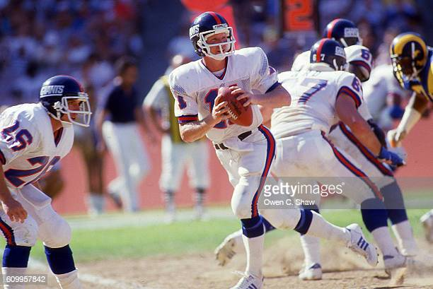 Phil Simms of the New York Giants circa 1984 drops back to pass against the Los Angeles Rams at Anaheim Stadium in Anaheim California