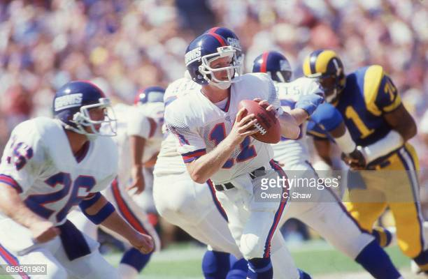 Phil Simms of the New York Giants circa 1986 drops back to pass against the Los Angeles Rams at Anahiem Stadium in Anahiem California