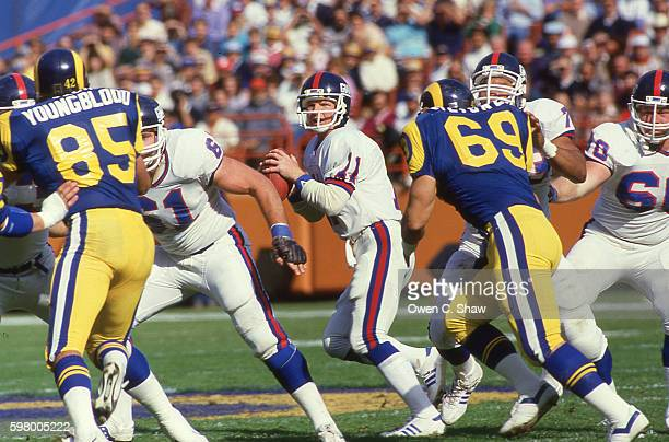 Phil Simms of the New York Giants circa 1987 drops back to pass against the Los Angeles Rams at Anaheim Stadium in Anaheim California