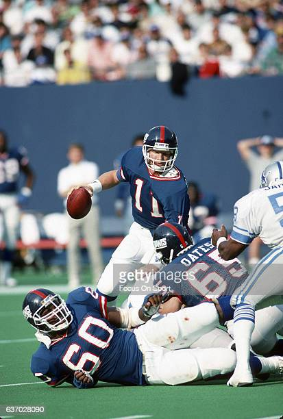Phil Simms of the New York Giants looks to get away from the pressure against the Detroit Lions during an NFL football game October 16 1988 at Giants...