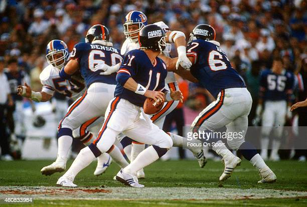 Phil Simms of the New York Giants looks to pass against the Denver Broncos during Super Bowl XXI on January 26 1987 at the Rose Bowl in Pasadena...