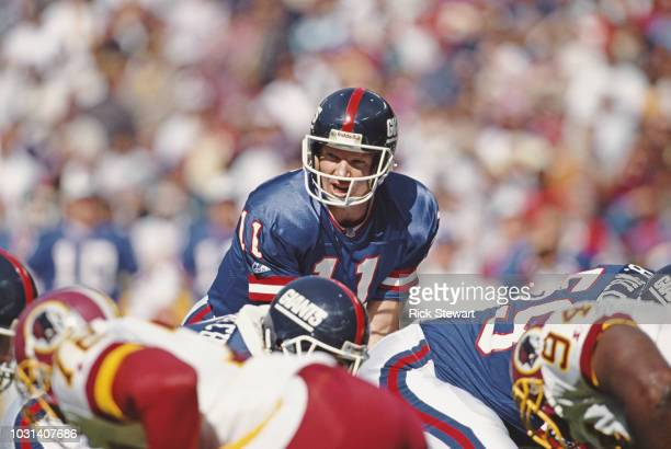 Phil Simms, Quarterback for the New York Giants calls the play during the National Football Conference East game against the Washington Redskins on...