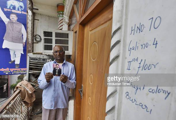 Phil Singh showing BSP Leader Munawwar Hasan'aPhoto outside the room he was found murdered on Saturday at Bhagat Colony burari Munawwar's five family...