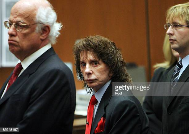 Phil Spector flanked by his lawyers Doran Weinberg and Tran Smith looks at the jury as it they arrive before the verdict was read at Los Angeles...