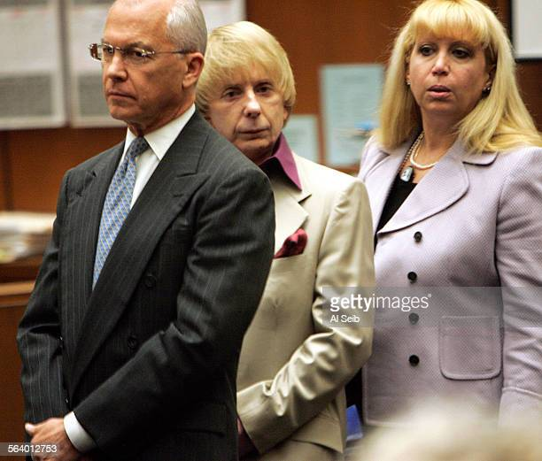 Phil Spector with his some of the members of his defense team attorney Roger Rosen left and attorney Linda Kenney Baden in Los Angeles criminal court...