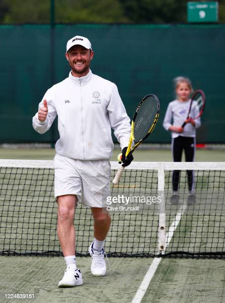 Phil Spencer Cheshire coach of the year 2019 in good spirits at the Bowdon Lawn Tennis Club whilst coaching 9yearold club member Gigi Welch today is...