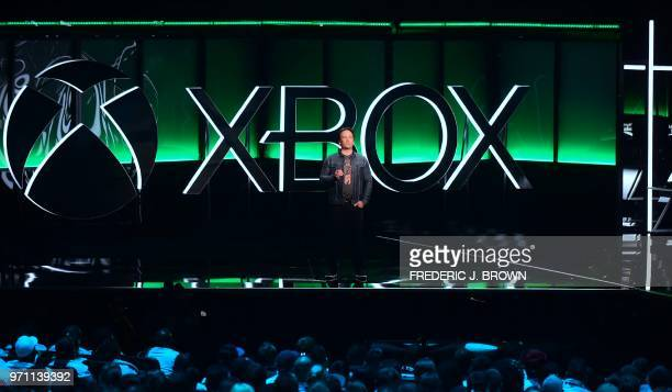 Phil Spencer Executive President of Gaming at Microsoft addresses the audience at the Xbox 2018 E3 briefing in Los Angeles California on June 10...