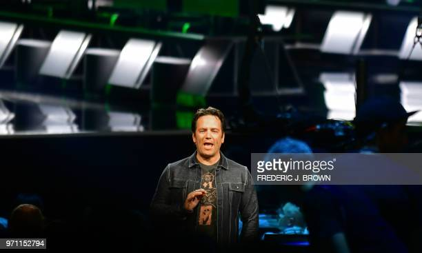 Phil Spencer Executive President of Gaming at Microsoft addresses the audience at the Xbox 2018 E3 briefing in Los Angeles California on June 10 2018...
