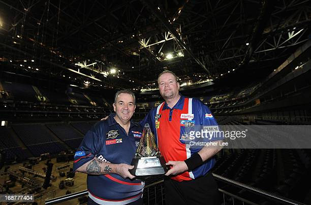 Phil Taylor and Raymond van Berneveld pose with the McCoys Premier League Trophy during the McCoy's Premier League Darts PlayOffs Media Launch at O2...