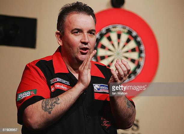 Phil Taylor applauds during his match against Bob Anderson during the 2005 Ladbrokescom World Darts Championship at The Circus Tavern on January 2...