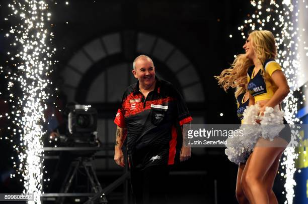 Phil Taylor arrives for his Quarter Final Match against Gary Anderson during the 2018 William Hill PDC World Darts Championships on Day Thirteen at...
