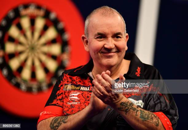 Phil Taylor celebrates after winning his Third Round Match against Keegan Brownduring the 2018 William Hill PDC World Darts Championships on Day...