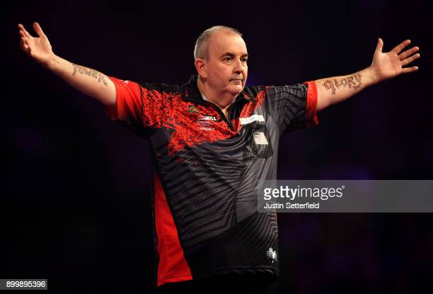 Phil Taylor celebrates during his Semi Final Match against Jamie Lewis during the 2018 William Hill PDC World Darts Championships at Alexandra Palace...