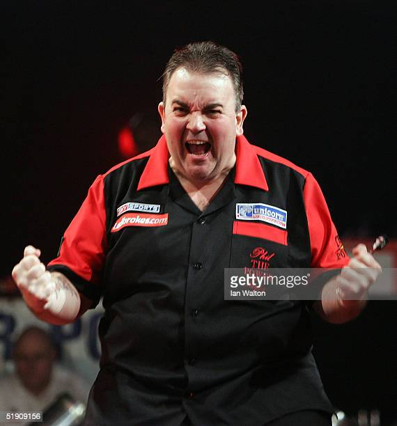 Phil Taylor celebrates winning his match against Bob Anderson during the 2005 Ladbrokescom World Darts Championship at The Circus Tavern on January 2...