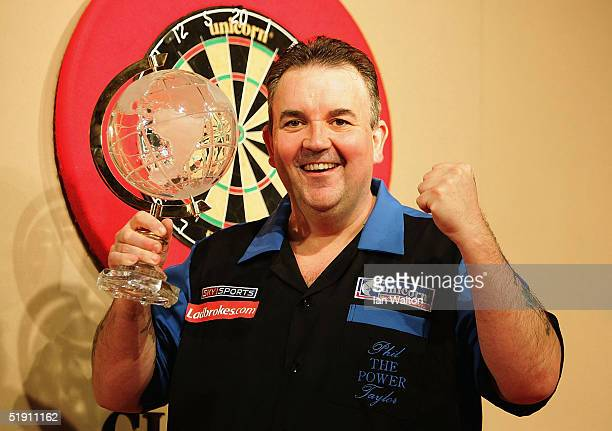 Phil Taylor celebrates winning his match against Mark Dudbridge in the Final of the 2005 Ladbrokescom World Darts Championship at The Circus Tavern...