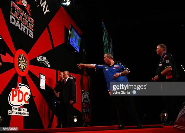 Phil Taylor competes in his match against Raymond van Barneveld of the Netherlands during the Whyte Mackay Premier League Darts at NIA Arena on March...