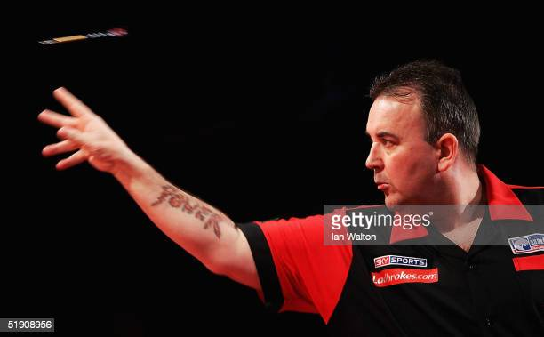 Phil Taylor in action during his match against Bob Anderson during the 2005 Ladbrokescom World Darts Championship at The Circus Tavern on January 2...