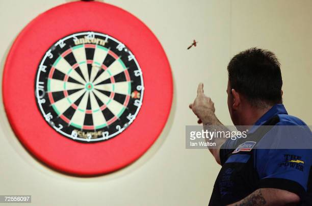 Phil Taylor in action during his match against Kevin Painter during the 2005 Ladbrokescom World Darts Championship at The Circus Tavern on January 1...