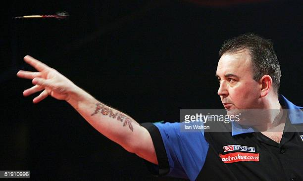 Phil Taylor in action during his match against Mark Dudbridge in the Final of the 2005 Ladbrokescom World Darts Championship at The Circus Tavern on...