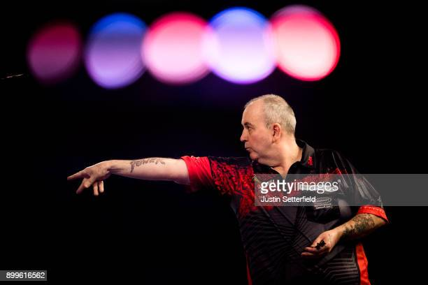 Phil Taylor in action during his Quarter Final Match against Gary Anderson during the 2018 William Hill PDC World Darts Championships on Day Thirteen...
