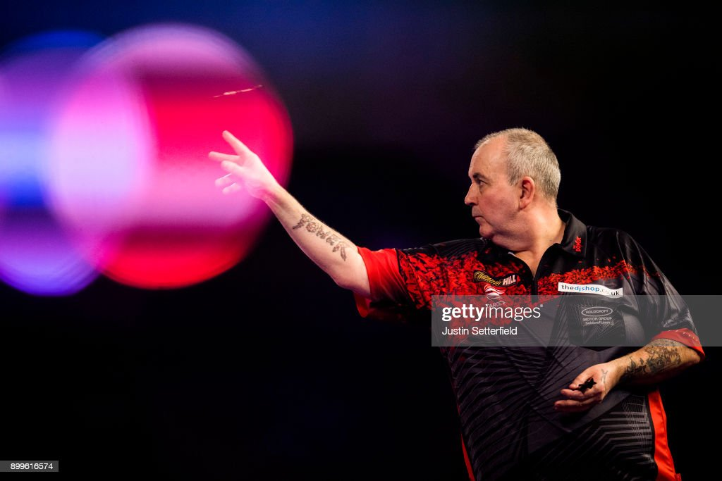 Phil Taylor in action during his Quarter Final Match against Gary Anderson during the 2018 William Hill PDC World Darts Championships on Day Thirteen at Alexandra Palace on December 29, 2017 in London, England.