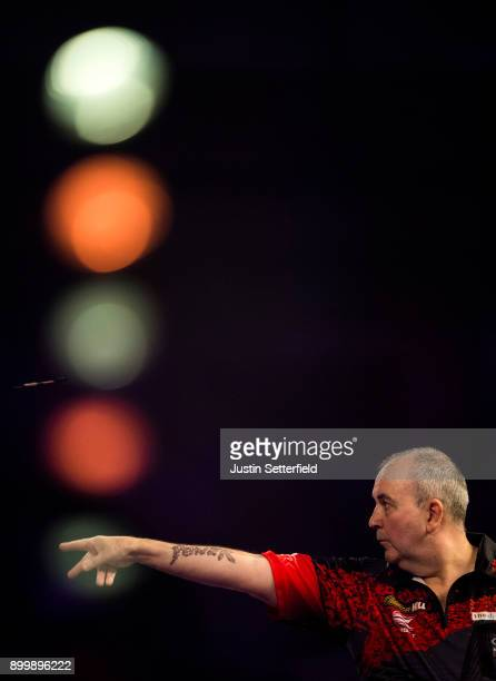 Phil Taylor in action during his Semi Final Match against Jamie Lewis during the 2018 William Hill PDC World Darts Championships at Alexandra Palace...