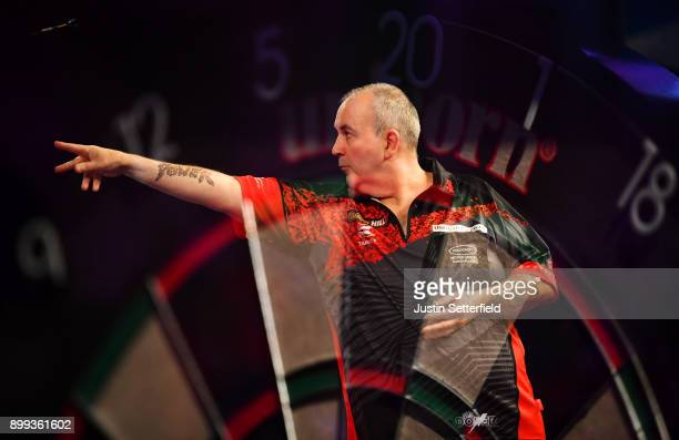 Phil Taylor in action during his Third Round Match against Keegan Brownduring the 2018 William Hill PDC World Darts Championships on Day Twelve at...