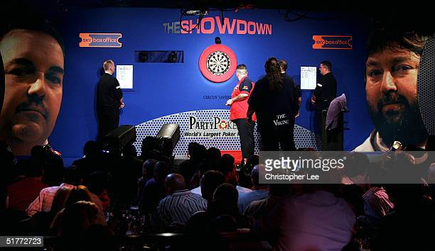 Phil Taylor in action during the Showdown match against Andy Fordham at The Circus Tavern on November 21 2004 in Purfleet England