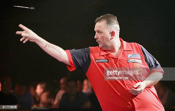 Phil Taylor in action during the Showdown match between Phil Taylor and Andy Fordham at The Circus Tavern on November 21 2004 in Purfleet England