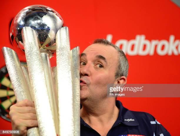 Phil Taylor lifts the trophy after winning the Ladbrokes.com World Darts Championship Final at Alexandra Palace, London.
