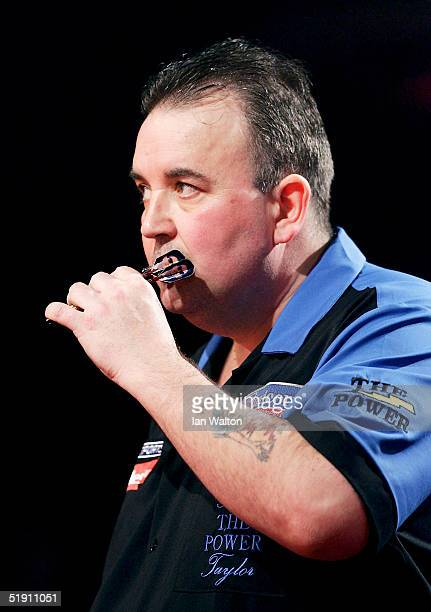Phil Taylor look on during his match against Mark Dudbridge in the Final of the 2005 Ladbrokescom World Darts Championship at The Circus Tavern on...