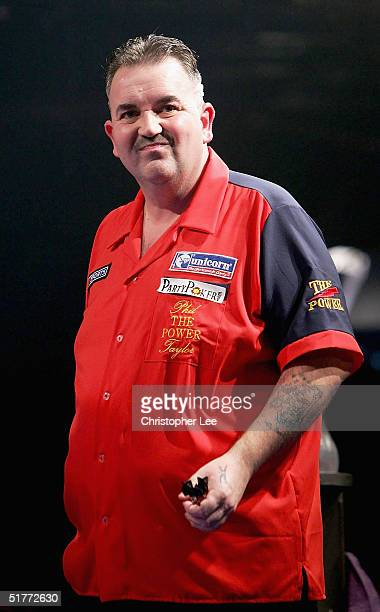 Phil Taylor looks pulls a face during the Showdown match between Phil Taylor and Andy Fordham at The Circus Tavern on November 21 2004 in Purfleet...