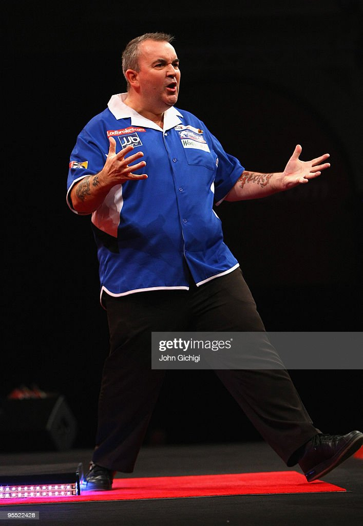 Phil Taylor of England celebrates during his game against Adrian Lewis of England during the Quarter Finals of the 2010 Ladbrokes.com World Darts Championships at Alexandra Palace on January 1, 2010 in London, England.