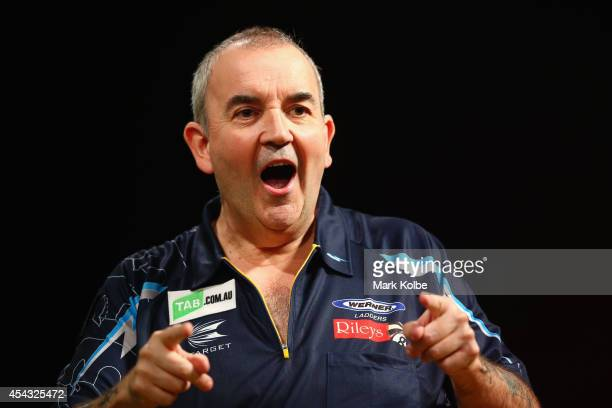 Phil Taylor of England celebrates victory in his quarterfinal match against Dave Chisnall of England during the Sydney Darts Masters at Hordern...