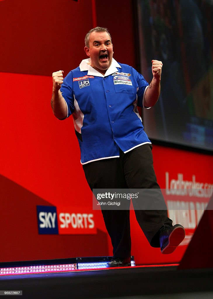 Phil Taylor of England celebrates winning his game against Adrian Lewis of England during the Quarter Finals of the 2010 Ladbrokes.com World Darts Championships at Alexandra Palace on January 1, 2010 in London, England.