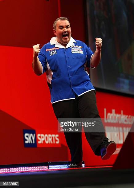 Phil Taylor of England celebrates winning his game against Adrian Lewis of England during the Quarter Finals of the 2010 Ladbrokescom World Darts...