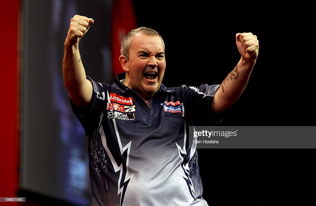 Phil Taylor of England celebrates winning his semi final match against Raymond van Barneveld of the Netherlands on day fourteen of the 2013 Ladbrokes.com World Darts Championship at the Alexandra Palace on December 30, 2012 in London, England.