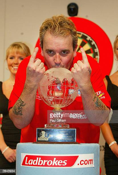 Phil Taylor of England celebrates winning the 2004 Ladbrokescom World Darts Championship in a sudden death play off against Kevin Painter of England...