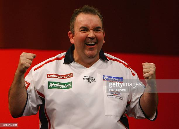 Phil Taylor of England celebrates winning the second round match between Phil Taylor of England and Mark Walsh of England during the 2008...