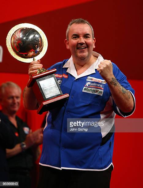 Phil Taylor of England holds his trophy for winning the world title for a record fifteenth time by beating Simon Whitlock of Australia in the final...