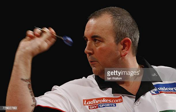 Phil Taylor of England in action against Darren Webster of England during the quarterfinals of the Ladbrokes World Darts Championship at The Circus...