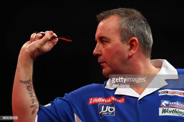 Phil Taylor of England in action against Mark Webster of Wales during the Semi Finals of the 2010 Ladbrokescom World Darts Championships at Alexandra...