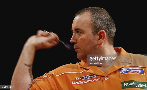 Phil Taylor of England in action against Raymond Van Barneveld of Holland during the final of the Ladbrokes World Darts Championship at The Circus...