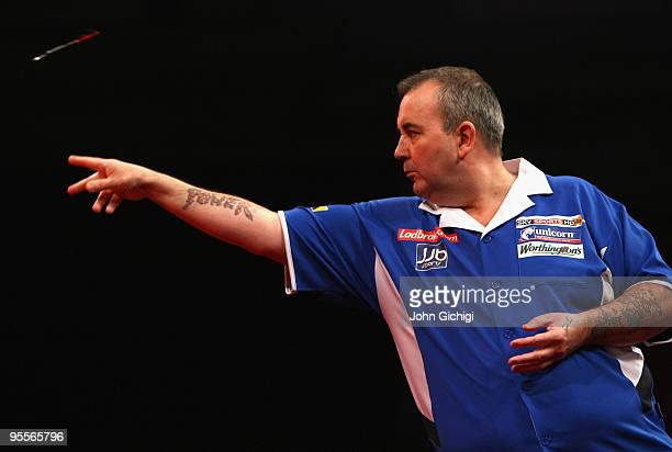 Phil Taylor of England in action against Simon Whitlock of Australia during the Final of the Ladbrokescom World Darts Championships at Alexandra...