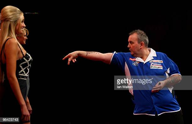 Phil Taylor of England in action against Steve Hine of England during the 2010 Ladbrokescom World Darts Championship Round One at Alexandra Palace on...