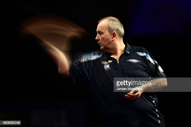 Phil Taylor of England in action during his first round match against Jyhan Artut of Germany on Day Two of the William Hill PDC World Darts...