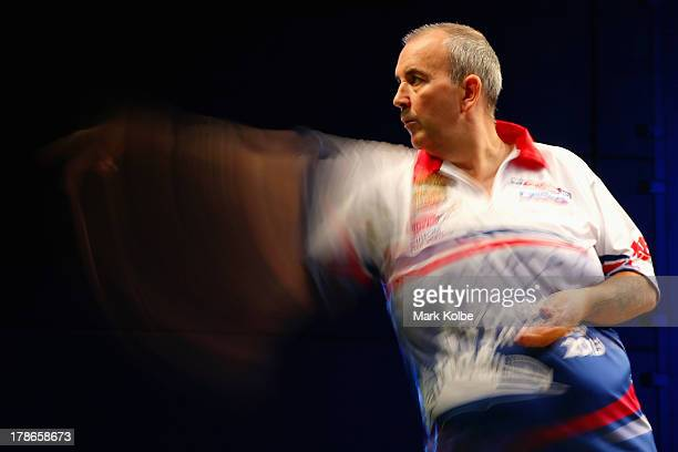 Phil Taylor of England in action during his quarterfinal match against Paul Nicholson of England during day two of the Sydney Darts Masters at Luna...