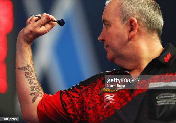 Phil Taylor of England in action during the PDC World Darts Championship final against Rob Cross of England on Day Fifteen at the 2018 William Hill...