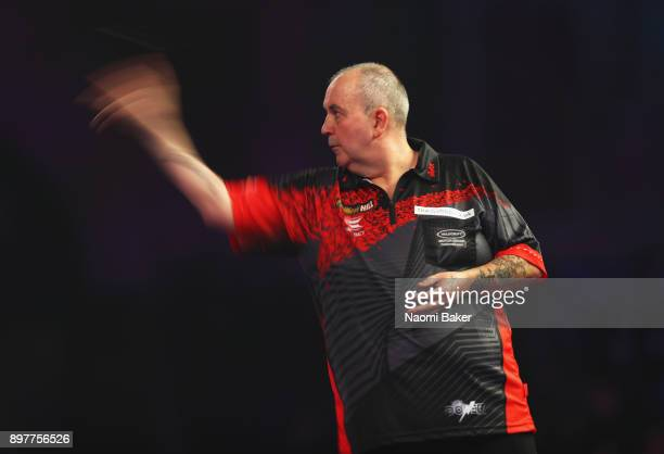 Phil Taylor of England in action during the second round match against Justin Pipe of England on day ten of the 2018 William Hill PDC World Darts...